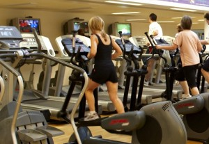 27355 STV Gym. Photos for publicity banner. Elouise on a bike being instructed by Sam. Client: Miles Peyton - Sports