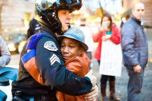 Child and Officer Embrace at Nonviolent Demonstration